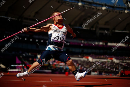 Britain's Kyron Duke runs in to throw during the men's javelin F40 category final during the athletics competition at the 2012 Paralympics, in London