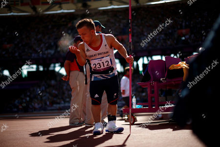 Stock Photo of Britain's Kyron Duke blows chalk from his hand as he prepares to throw in the men's javelin F40 category final during the athletics competition at the 2012 Paralympics, in London