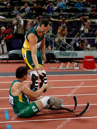 Stock Image of Gold medalist South Africa's Oscar Pistorius, top, shakes hands with fourth place finisher Brazil's Alan Oliveira after they ran in the men's 400 meters T44 category final during the athletics competition at the 2012 Paralympics, in London