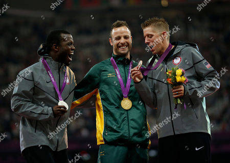 Gold medalist South Africa's Oscar Pistorius, center, laughs with silver medalist Blake Leeper, left, and bronze medalist David Prince both from the U.S. as they pose for photographers after the ceremony for the men's 400 meters T44 category final during the athletics competition at the 2012 Paralympics, in London