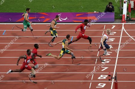 From the top, Alan Fonteles Cardoso Oliveira, from Brazil, Oscar Pistorius from South Africa, Richard Browne from the United States, Jonnie Peacock from Great Britain, Arnu Fourie from South Africa, Blake Leeper from the United States and Jerome Singleton from the United States compete in the Men's 100 meter - T44 category final at the 2012 Paralympics games, in London. Jonnie Peacock took the gold medal