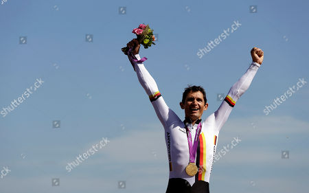 Michael Teuber of Germany celebrates with his gold medal during the medal ceremony for the men's road cycling individual time trial C1 category at the 2012 Paralympics games, at Brands Hatch motor racing circuit near London