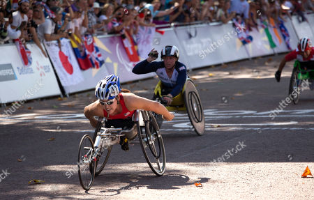 United States' Shirley Reilly, left, followed by Britain's Shelly Woods and Switzerland's Sandra Graf, right, wins a women's marathon T54 category at the 2012 Paralympics, in London