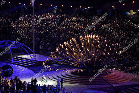 Stock Picture of Margaret Maughan, bottom left, Britain's first Paralympic gold medalist, lights the Paralympic flame during the Opening Ceremony for the 2012 Paralympics in London