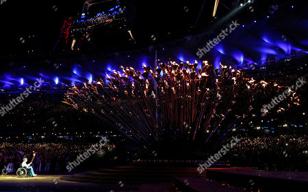 Margaret Maughan, Britain's first Paralympic gold medalist, lights the Paralympic flame during the Opening Ceremony for the 2012 Paralympics in London