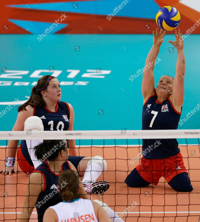 Britain's Martine Wright, right, returns the ball during the Britain versus Netherlands sitting volleyball preliminary match at the 2012 Paralympics, in London. Netherlands won the match
