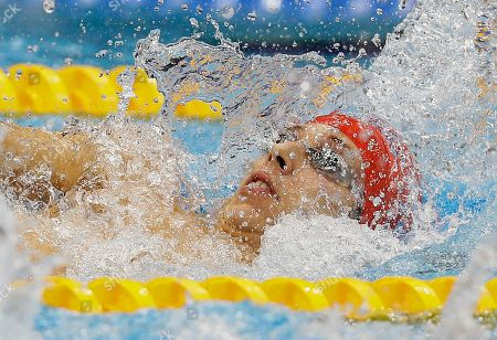 Britain's Jonathan Fox swims towards winning gold in the men's 100m Backstroke S7 category at the 2012 Paralympics, in London