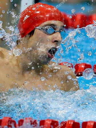 Britain's Jonathan Fox celebrates winning gold in the men's 100m Backstroke S7 category at the 2012 Paralympics, in London