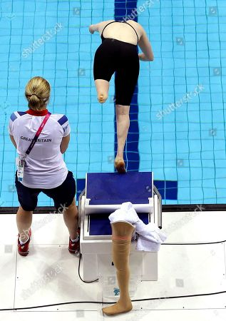 Britain's Susannah Rodgers dives for the women's 50m Butterfly S7 category at the 2012 Paralympics, in London