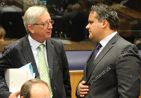 Stock Image of Jean-Claude Juncker, Jan Kees De Jager Luxembourg's Prime Minister and President of the Eurogroup Jean-Claude Juncker, left, talks with Dutch Finance Minister Jan Kees De Jager, during the Eurogroup finance ministers meeting, in Luxembourg, . Finance ministers from the nations sharing the euro currency assess the latest developments in the financial crisis