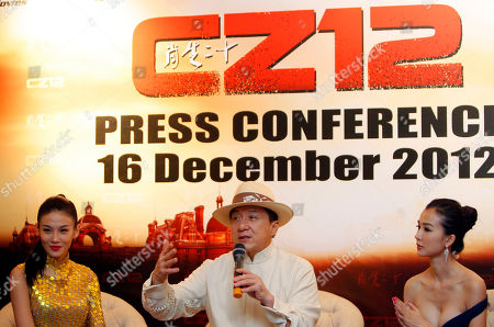 "Jackie Chan, Zhang Lanxin, Yao Xintong Hong Kong movie star Jackie Chan, center, speaks as Chinese actresses Zhang Lanxin, left, and Yao Xintong listen during a press conference to promote their new movie ""CZ12"" in Kuala Lumpur, Malaysia"