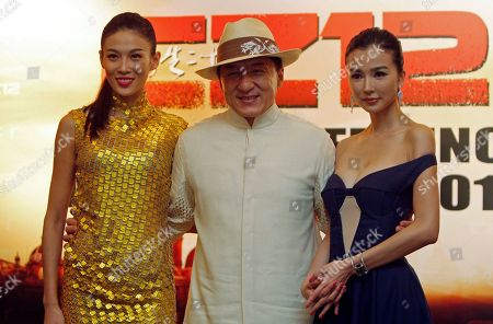 "Jackie Chan, Zhang Lanxin, Yao Xintong Hong Kong movie star Jackie Chan, center, poses for photographers with Chinese actresses Zhang Lanxin, left, and Yao Xintong during a press conference to promote their new movie ""CZ12"" in Kuala Lumpur, Malaysia"