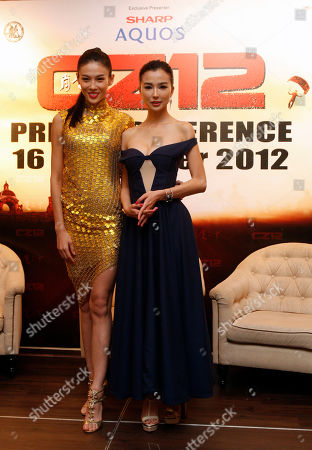"Zhang Lanxin, Yao Xintong Chinese actresses Zhang Lanxin, left, and Yao Xintong pose for photographers during a press conference to promote their new movie ""CZ12"" in Kuala Lumpur, Malaysia"
