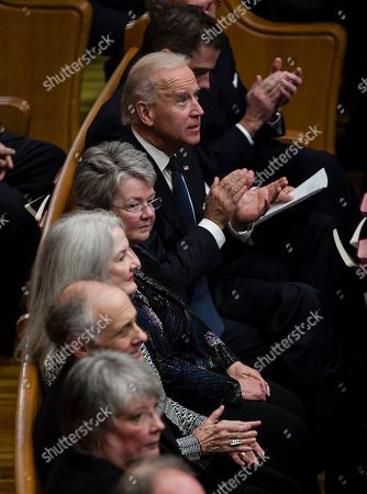 Hunter Biden, Joe Biden, Ann McGovern, Susan Rowen Hunter Biden, top, sits with his father Vice President Joe Biden, and daughters of George McGovern Ann McGovern, third from top and Susan Rowen, fourth from top, at a prayer service for former Democratic U.S. senator and three-time presidential candidate George McGovern at the First United Methodist Church in Sioux Falls, S.D., . McGovern died last Sunday in his native South Dakota at age 90