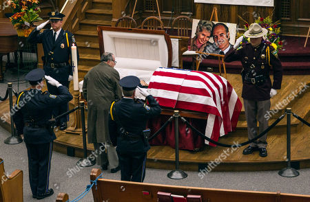 A man pays his respects at the public viewing for former Democratic U.S. senator and three-time presidential candidate George McGovern at the First United Methodist Church in Sioux Falls, S.D., as an honor guard salutes, . McGovern died Sunday in his native South Dakota at age 90