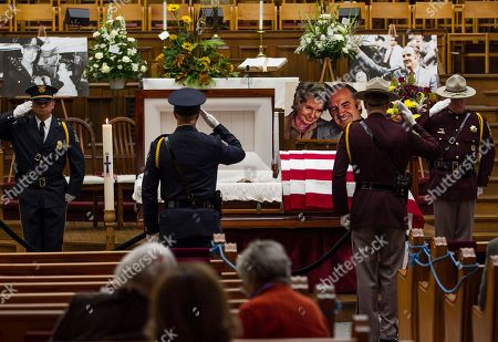 Members of the honor guard salute at the public viewing for former Democratic U.S. senator and three-time presidential candidate George McGovern at the First United Methodist Church in Sioux Falls, S.D., . McGovern died Sunday in his native South Dakota at age 90