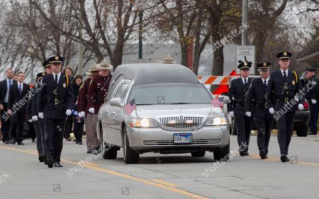 An honor guard followed by family members accompany the hearse carrying former Democratic U.S. Senator and three-time presidential candidate George McGovern, on the way to the Washington Pavilion of Arts and Science in Sioux Falls, S.D., for his funeral service, . McGovern died Sunday in his native South Dakota at age 90