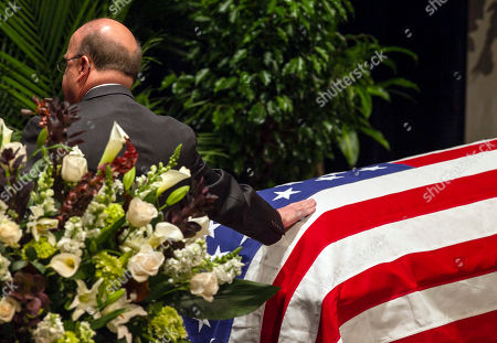 Jim McGovern Rep. Jim McGovern D-Mass., places his hand on the casket of former Democratic U.S. Senator and three-time presidential candidate George McGovern, as he takes leave of him at his funeral service at the Washington Pavilion of Arts and Science in Sioux Falls, S.D., . McGovern died Sunday in his native South Dakota at age 90