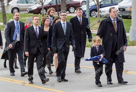 Will Mead, Tim Mead Great grandson Will Mead and his father Tim Mead, front, lead family members as they walk behind the hearse carrying the casket of former Democratic U.S. Senator and three-time presidential candidate George McGovern, on the way to the Washington Pavilion of Arts and Science in Sioux Falls, S.D., for his funeral service, . McGovern died Sunday in his native South Dakota at age 90