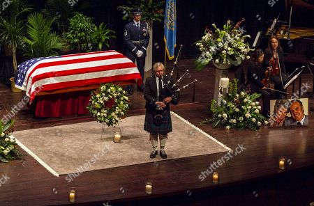 Tom Parliman Tom Parliman plays the bagpipes at the end of a funeral service for former Democratic U.S. Senator and three-time presidential candidate George McGovern at the Washington Pavilion of Arts and Science in Sioux Falls, S.D., . McGovern died Sunday in his native South Dakota at age 90