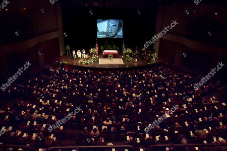 Stock Picture of Mourners fill the hall at a funeral service for former Democratic U.S. Senator and three-time presidential candidate George McGovern at the Washington Pavilion of Arts and Science in Sioux Falls, S.D., . McGovern died Sunday in his native South Dakota at age 90