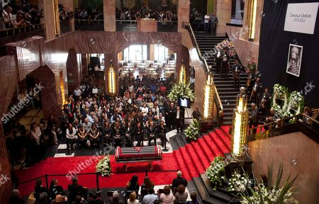 People mourn next to the coffin of the late Mexican singer Chavela Vargas during her wake at the Palace of Fine Arts in Mexico City, . Chavela Vargas, who defied gender stereotypes to become one of the most legendary singers in Mexico, died Aug. 5 at age 93