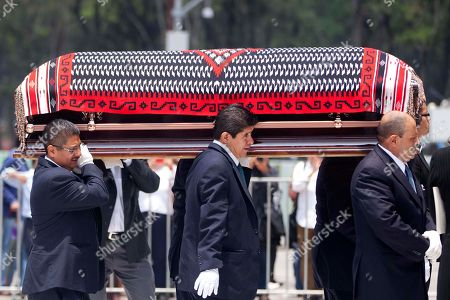 Men carry the coffin containing the body of the late Mexican singer Chavela Vargas prior to her wake in Bellas Artes Palace in Mexico City, . Chavela Vargas, who defied gender stereotypes to become one of the most legendary singers in Mexico, died Aug. 5 at age 93