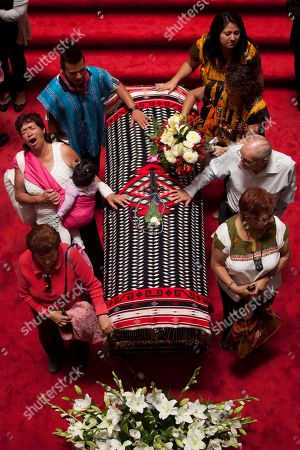 People mourn next to the draped casket of the late Mexican singer Chavela Vargas during her wake in the Palace of Fine Arts in Mexico City, . Chavela Vargas, who defied gender stereotypes to become one of the most legendary singers in Mexico, died Aug. 5 at age 93