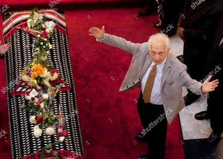 Sergio Pitol Mexican writer Sergio Pitol gestures as he mourns next to the draped casket of the late Mexican singer Chavela Vargas during her wake in Bellas Artes Palace in Mexico City, Tueday, . Chavela Vargas, who defied gender stereotypes to become one of the most legendary singers in Mexico, died Aug. 5 at age 93