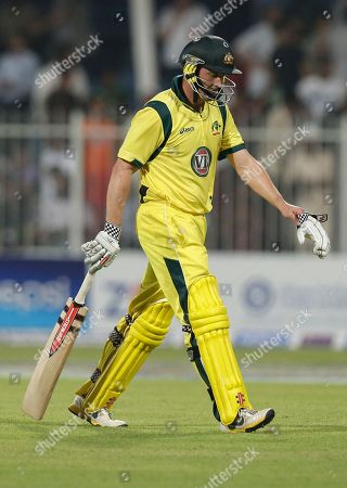 Australia's David Hussey walks off the field of play after losing his wicket to Pakistan's bowler Saeed Ajmal, not pictured, during the first cricket ODI match of a three match series between Australia and Pakistan at Sharjah Cricket Stadium, in Sharjah, United Arab Emirates