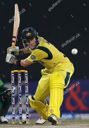 Australia's David Hussey hits a six during the third cricket ODI match of a three match series between Australia and Pakistan, at Sharjah Cricket Stadium, in Sharjah, United Arab Emirates