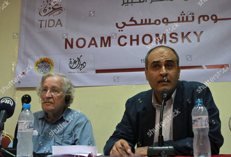 Jewish-American scholar and activist Noam Chomsky and Amjad Shawwa the director of PNGO the Gaza based umbrella group of the NGOS, right, talk during their meeting with Palestinian youth activists in Gaza City, . Chomsky crossed from Egypt yesterday for his first visit to Gaza