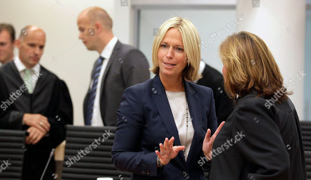 """Stock Photo of Anders Behring Breivik Public prosecutor Bejer Engh, center, speaks to lawyer Vibeke Hein, right, while lawyer Geir Lippestad, rear left, talks to prosecutor Sven Holden in the courtroom, in Oslo, Norway. Anders Behring Breivik has been declared sane and sentenced to prison for bomb and gun attacks that killed 77 people last year. Reading the ruling, Judge Wenche Elisabeth Arntzen handed down a sentence of """"preventive detention"""" of at least 10 years and a maximum of 21 years. However, such sentences can be extended under Norwegian law as long as an inmate is considered dangerous"""