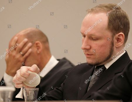 """Anders Behring Breivik Anders Behring Breivik sits beside his lawyer Geir Lippestad, left, in the courtroom, in Oslo, Norway. A chapter of a terror case that has haunted Norway for 13 months ended Friday as confessed mass killer Anders Behring Breivik was declared sane and sent to prison for bomb and gun attacks that killed 77 people and injured 200 others last year. After deliberating for two months, a five-judge panel in Oslo's district court handed down a sentence of """"preventive detention"""" of at least 10 years and a maximum of 21 years for the right-wing extremist"""