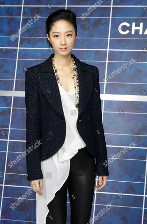 Guey Lun-Mei poses for photographers as she arrives for Chanel's ready to wear Spring-Summer 2013 collection, presented in Paris, Tuesday, Oct.2, 2012