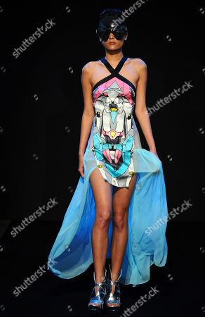 A model shows a creation by British fashion designers and brothers Eri and Philip Chu for Ground Zero fashion house's ready to wear Spring-Summer 2013 collection, in Paris, Sunday, Sept.30, 2012