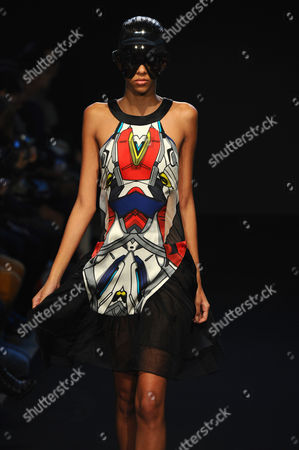 A model shows a creation by British fashion designers and brothers Eri and Philip Chu for Ground Zero fashion house's ready to wear Spring-Summer 2013 collection, in Paris