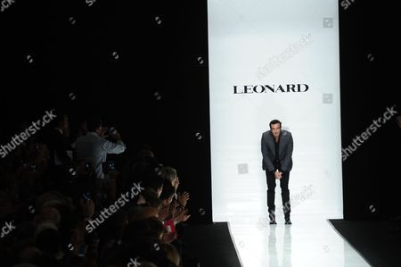 Italian artistic director Raffaele Borriello reacts after the presentation of Leonard's ready to wear Spring-Summer 2013 collection, presented in Paris, Monday, Oct.1, 2012