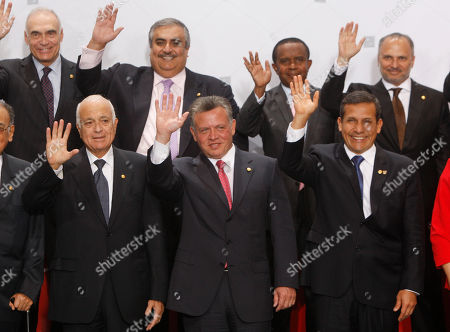 Anwar Mohammad Gargash, Ahmed Ben Said Jaffare, Sheikh Khalid bin Ahmed Al Khalifa, Mohammed Kamel Amr, Ollanta Humala, King Abdullah II of Jordan, Nabil El Araby Egyptian Foreign Minister Mohammed Kamel Amr, from top left, clockwise, Bahrain's Foreign Minister Sheikh Khalid bin Ahmed Al Khalifa, Minister of Foreign Affairs of the Comoros Islands Ahmed Ben Said Jaffare, Minister of State for Foreign Affairs of The United Arab Emirates Anwar Mohammad Gargash, Peru's President Ollanta Humala, King Abdullah II of Jordan and Arab League Secretary General Dr. Nabil El Araby, wave for the official group photo during a summit of heads of state and government representatives from South American and Arab countries in Lima, Peru