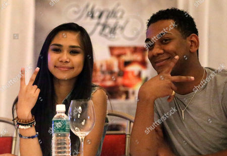 """Jessica Sanchez, Joshua Ledet Jessica Sanchez, left, the runner-up in season 11 of the reality singing show """"American Idol"""" and one of the top ten finalists Joshua Ledet, pose for photographers during a news conference at the Manila Hotel, in Manila, Philippines. The top ten American Idol finalists, led by season 11 winner Phillip Phillips and hometown favorite Sanchez, whose mother is from the Philippines, arrived Tuesday for a concert as part of their American Idol Live! Tour 2012"""