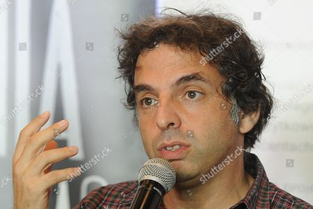 """Etgar Keret Israeli writer Etgar Keret speaks during a press conference one day ahead of the official opening of one of the world's narrowest houses, in Warsaw, Poland, . The two-level """"Keret's House"""" is no wider than 122 centimeters (48.03 inches) and was fitted into tiny space puzzlingly left between a pre-war house and a modern apartment block of the 1960s in downtown Warsaw. It is named after Etgar Keret, an Israeli writer of Polish roots who will be the first inhabitant of this artistic project of aluminum and polycarbonate"""