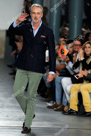 American fashion designer Michael Bastian reacts after his Spring/Summer 2013 fashion collection, presented in Portugal Fashion week, in Porto, Portugal