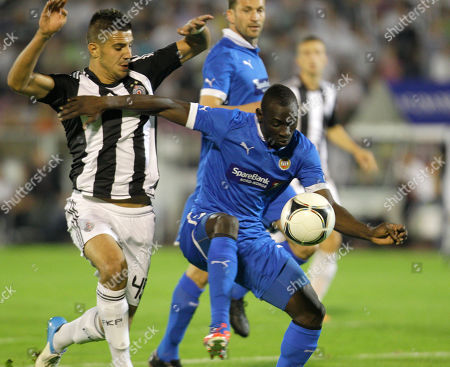 Tromso's Saliou Ciss, right, and FK Partizan's Aleksandar Mitrovic fight for the ball during their UEFA Europa League play-off second leg soccer match between FK Partizan Belgrade and Tromso, in Belgrade, Serbia