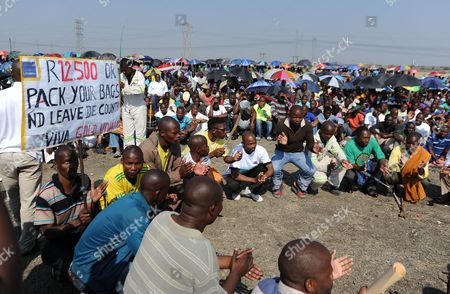 Striking Lonmin Platinum miners gather in Marikana, South Africa, where a new wage offer was rejected . As various stakeholders continued negotiations Justice Minister Jeff Radebe warned that the Government would clamp down on daily illegal marches by miners brandishing machetes, spears and clubs that have marked the strike