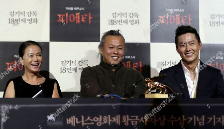Kim Ki-duk, Cho Min-soo, Lee Jung-jin South Korean director Kim Ki-duk, center, who won the Golden Lion for best movie at this year's Venice Film Festival, smiles with actress Cho Min-soo, left, and actor Lee Jung-jin during a press conference in Seoul, South Korea, . Kim said he hopes the prize will encourage theater owners who have previously shunned his works to screen them more often