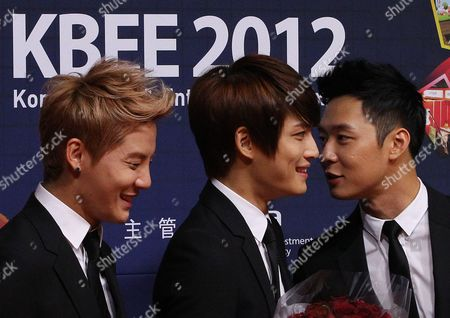 Kim Jun-su, Kim Jae-joon, Park Yu-chun South Korean K-pop group JYJ members Kim Jun-su, left, Kim Jae-joong, and Park Yu-chun, right, smile after they were appointed as the publicity ambassadors for KBEE 2012, Korea Brand & Entertainment Expo 2012, which will be held in Nov. 14-16 in Osaka, Japan, at the headquarters of Korea Trade-Investment Promotion Agency in Seoul, South Korea