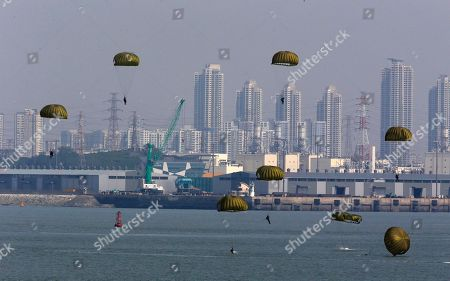 South Korean Special forces soldiers parachute down during the 62nd Incheon Landing Operations Commemoration ceremony in waters off Incheon, South Korea, . Incheon is the coastal city where United Nations Forces led by U.S. General Douglas MacArthur landed in September, 1950 just months after North Korea invaded the South
