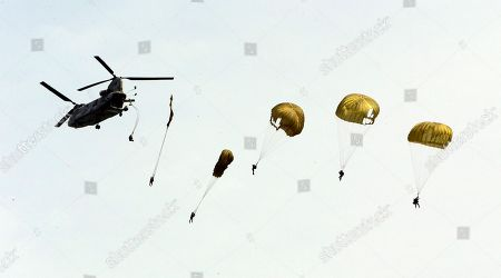 South Korean Special Forces soldiers parachute down from a helicopter during the 62nd Incheon Landing Operations Commemoration ceremony in waters off Incheon, South Korea, . Incheon is the coastal city where United Nations Forces led by U.S. General Douglas MacArthur landed in September, 1950 just months after North Korea invaded the South