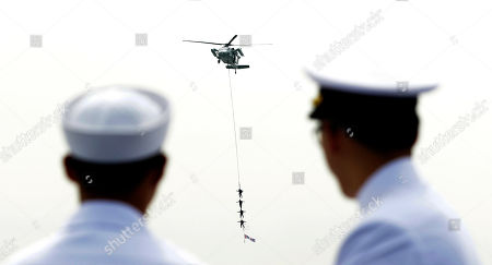 South Korean Special Navy seamen hang on the rope from a helicopter during the 62nd Incheon Landing Operations Commemoration ceremony in waters off Incheon, South Korea . Incheon is the coastal city where United Nations Forces led by U.S. General Douglas MacArthur landed in September, 1950 just months after North Korea invaded the South