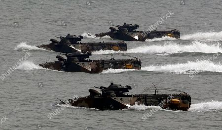 South Korean marine landing craft make their way during the 62nd Incheon Landing Operations Commemoration ceremony, in waters off Incheon, South Korea. Incheon is the coastal city where United Nations Forces led by U.S. General Douglas MacArthur landed in September, 1950 just months after North Korea invaded the South